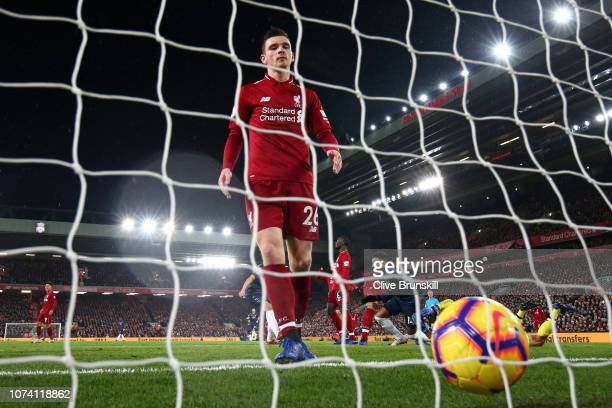 Andy Robertson of Liverpool looks dejected as Jesse Lingard of Manchester United celebrates after scoring his team's first goal during the Premier...