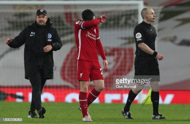 Andy Robertson of Liverpool looks dejected following the Premier League match between Liverpool and Brighton & Hove Albion at Anfield on February 03,...