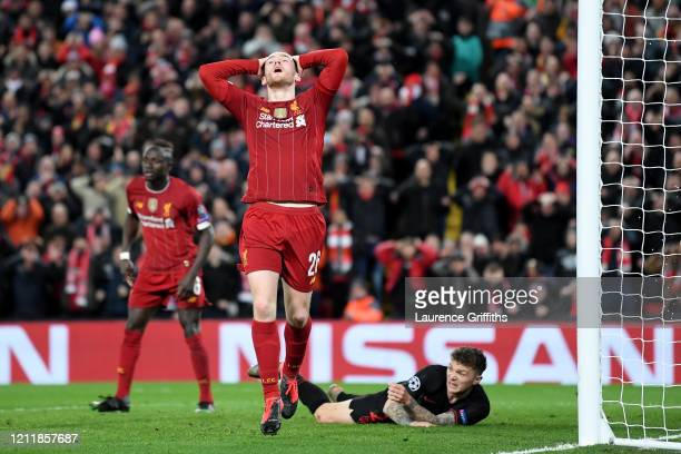 Andy Robertson of Liverpool reacts following shooting and missing from hitting the crossbar during the UEFA Champions League round of 16 second leg...