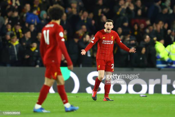 Andy Robertson of Liverpool reacts towards teammate Mohamed Salah after conceding the third goal during the Premier League match between Watford FC...