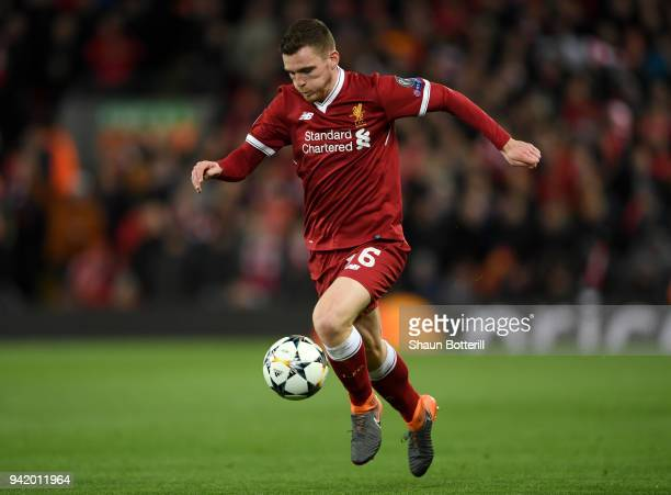 Andy Robertson of Liverpool runs with the ball during the UEFA Champions League Quarter Final Leg One match between Liverpool and Manchester City at...