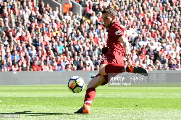 Andy Robertson of Liverpool scores his sides fourth goal during the Premier League match between Liverpool and Brighton and Hove Albion at Anfield on...