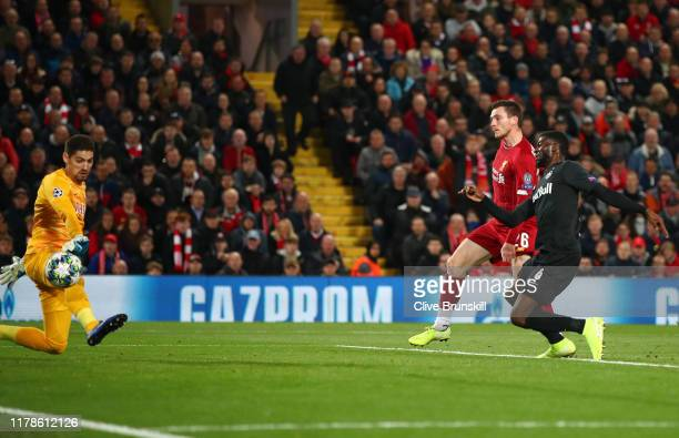 Andy Robertson of Liverpool scores his sides second goal during the UEFA Champions League group E match between Liverpool FC and RB Salzburg at...