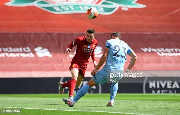 Andy Robertson of Liverpool scores his team's first goal during the Premier League match between Liverpool FC and Burnley FC at Anfield on July 11,...