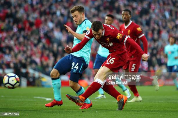 Andy Robertson of Liverpool shoots while under pressure from Ryan Fraser of AFC Bournemouth during the Premier League match between Liverpool and AFC...