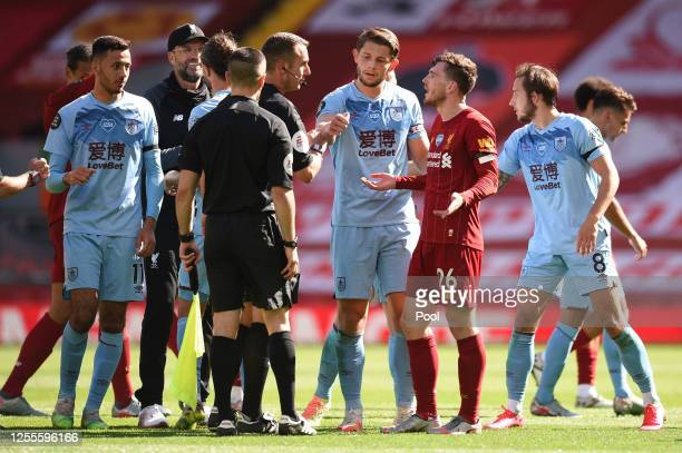 Andy Robertson of Liverpool speaks with Match Referee David Coote following the Premier League match between Liverpool FC and Burnley FC at Anfield...