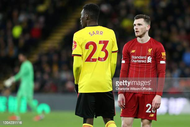 Andy Robertson of Liverpool stares at Ismaila Sarr of Watford during the Premier League match between Watford FC and Liverpool FC at Vicarage Road on...