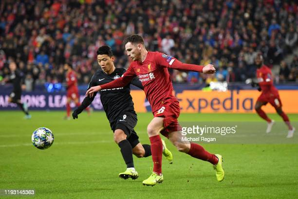 Andy Robertson of Liverpool under pressure from Hwang Heechan of Red Bull Salzburg during the UEFA Champions League group E match between RB Salzburg...