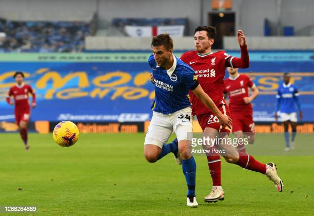 Andy Robertson of Liverpool with Brighton & Hove Albion's Joel Veltman during the Premier League match between Brighton & Hove Albion and Liverpool...