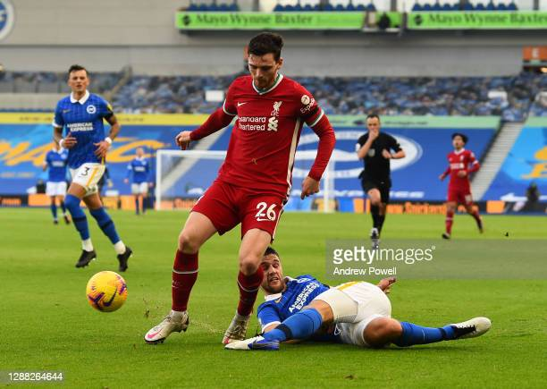 Andy Robertson of Liverpool with Brighton & Hove Albion's Lewis Dunk during the Premier League match between Brighton & Hove Albion and Liverpool at...