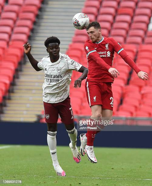 Andy Robertson of Liverpool with Bukayo Saka of Arsenal during the FA Community Shield final at Wembley Stadium on August 29 2020 in London England