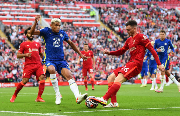Andy Robertson of Liverpool with Chelsea's Thiago Silva during the Premier League match between Liverpool and Chelsea at Anfield on August 28, 2021...