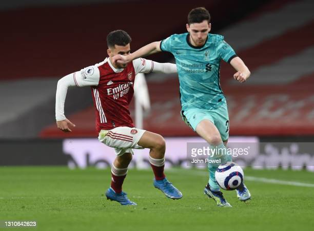 Andy Robertson of Liverpool with Dani Ceballos of Arsenal during the Premier League match between Arsenal and Liverpool at Emirates Stadium on April...