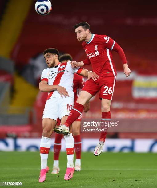Andy Robertson of Liverpool with Southampton's Charlie Austin during the Premier League match between Liverpool and Southampton at Anfield on May 08,...