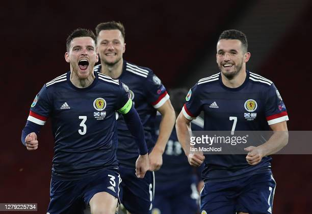 Andy Robertson of Scotland celebrates after his teams victory in the penalty shoot out during the UEFA EURO 2020 Play-Off semi-finals match between...