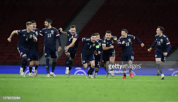 Andy Robertson of Scotland celebrates with his team after his teams victory in the penalty shoot out during the UEFA EURO 2020 Play-Off semi-finals...