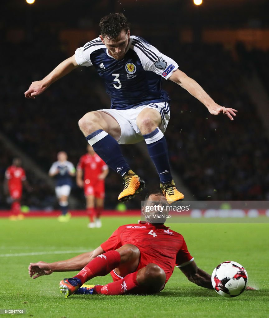GLASGOW, SCOTLAND - SEPTEMBER 04 Andy Robertson of Scotland leaps over Steve Borg of Malta during the FIFA 2018 World Cup Qualifier between Scotland and Malta at Hampden Park on September 4, 2017 in Glasgow, Scotland.