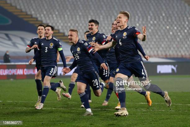 Andy Robertson of Scotland , Leigh Griffiths of Scotland and Scott McTominay of Scotland celebrate after their victory in the UEFA EURO 2020 Play-Off...