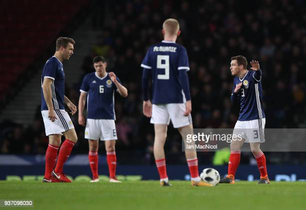 Andy Robertson of Scotland reacts after Marco Urena of Costa Rica scores the opening goal during the Vauxhall International Challenge match between...