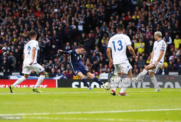 Andy Robertson of Scotland scores the opening goal during the European Qualifier for UEFA Euro 2020 at Hampden Park on June 08 2019 in Glasgow...