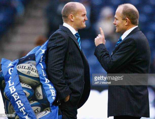 Andy Robinson coach of Scotland tackles talks with Gregor Townsend on the pitch before the Bank Of Scotland Corporate Autumn Test match between...