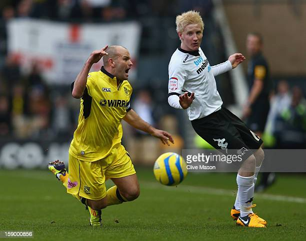 Andy Robinson of Tranmere Rovers is tackled by Will Hughes of Derby County during the FA Cup with Budweiser Third Round match between Derby County...