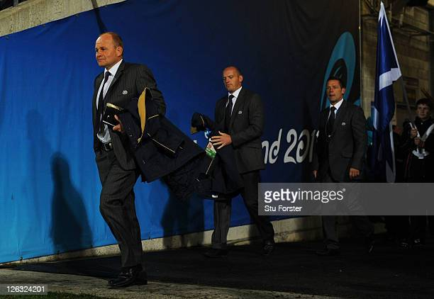 Andy Robinson the coach of Scotland attack coach Gregor Townsend and defence coach Graham Steadman walk out onto the pitch prior to kickoff during...