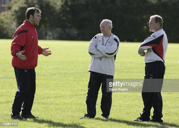Andy Robinson the England Head Coach talks with his assistant coaches Brian Ashton and John Wells during the England Rugby Union training session at...