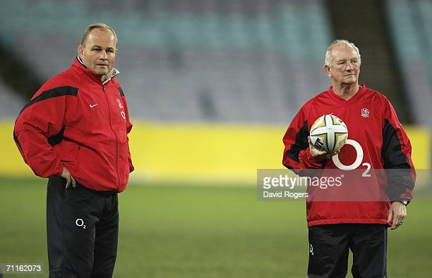 Andy Robinson,, the England Head Coach with attack coach Brian Ashton watch the team during a England training session held at the Telstra Stadium on...