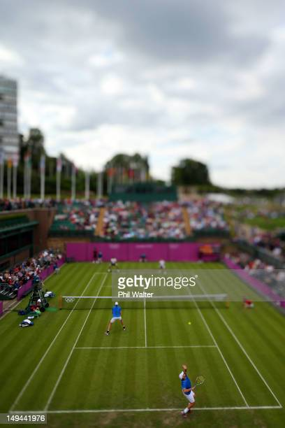Andy Roddick and John Isner of the United States of America play against Marcelo Melo and Bruno Soares of Brazil on Day 1 of the London 2012 Olympic...