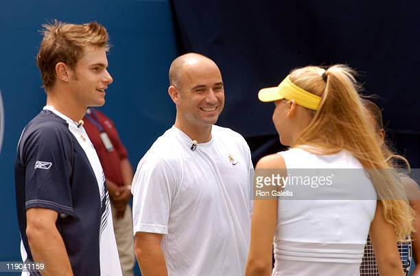 Andy Roddick, Andre Agassi and Anna Kournikova during 2003 US Open - Arthur Ashe Kids Day at USTA National Tennis Center in Queens, New York, United...