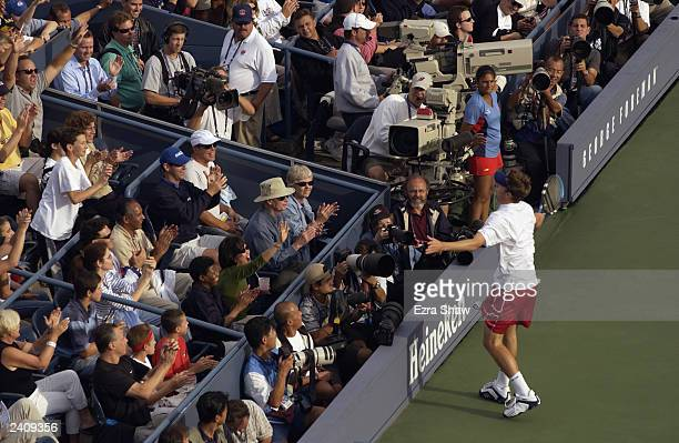 Andy Roddick bows to the crowd after making a diving shot while playing Raemon Sluiter of the Netherlands during the US Open August 30 2002 at the...