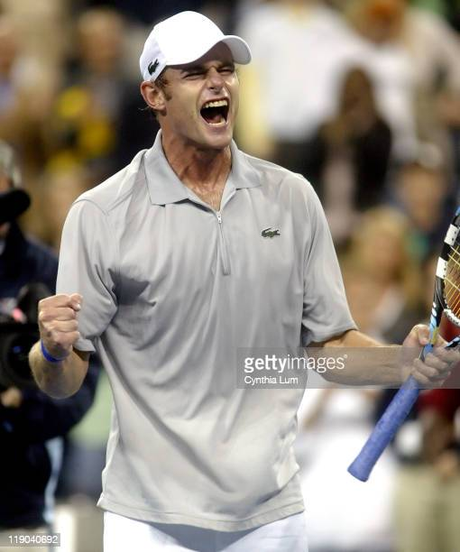 Andy Roddick celebrates his defeat over Australia's Lleyton Hewitt 63 75 64 in the quarter final of the US Open at the USTA Billie Jean King National...