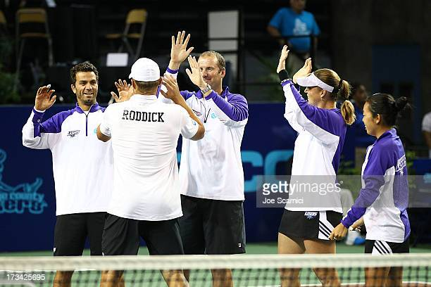Andy Roddick congratulates Jean Julien Rojer Coach JohnLaffnie de Jager Alisa Kleybanova and Vania King as the Springfield Lasers take on the Orange...