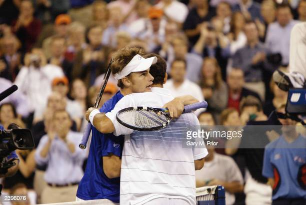 Andy Roddick congratulates Pete Sampras after their match during the US Open on September 5 2002 at the USTA National Tennis Center in Flushing...