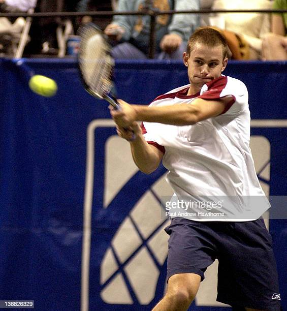 Andy Roddick hits a return shot during his match with Kristof Vliegen of Belgium at the 2004 Siebel Open in San Jose, California, February 12, 2004....