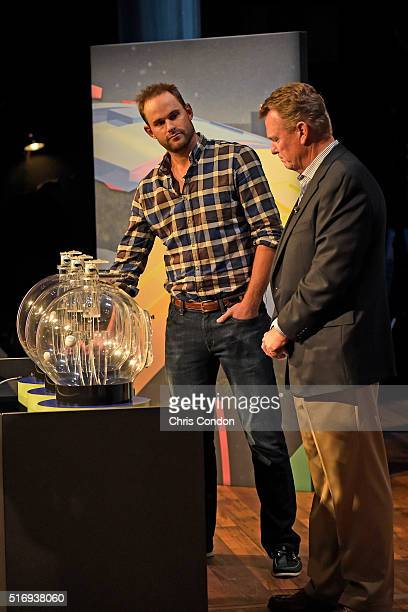 Andy Roddick hits the button as Tournament Official Steve Rintoul looks on during the live broadcast of the Dell Match Play Bracket Special at the...