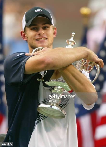Andy Roddick holds close the winner's trophy after defeating Juan Carlos Ferrero of Spain during the US Open men's singles final at the USTA National...
