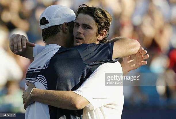 Andy Roddick hugs his old friend Mardy Fish after defeating him for his second straight Masters Series title during the finals of the Western and...