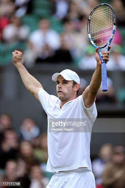 Andy Roddick of the United States celebrates winning his second round match against Victor Hanescu of Romania on Day Three of the Wimbledon Lawn...