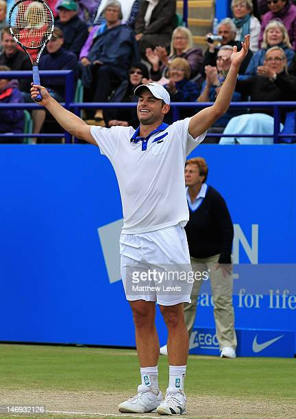 Andy Roddick of the United States of America celebrates winning match point against Andreas Seppi of Italy during the Mens Singles Final day eight of...