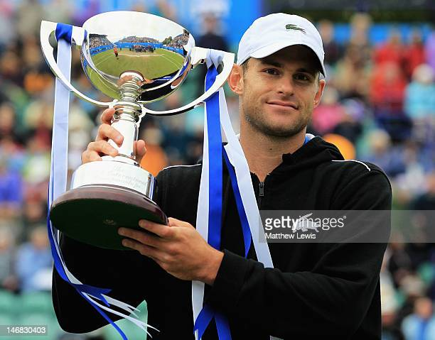 Andy Roddick of the United States of America pictured with the trophy winning the Mens Singles Final against Andreas Seppi of Italy day eight of the...
