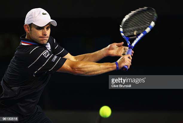 Andy Roddick of the United States of America plays a backhand in his fourth round match against Fernando Gonzalez of Chile during day seven of the...