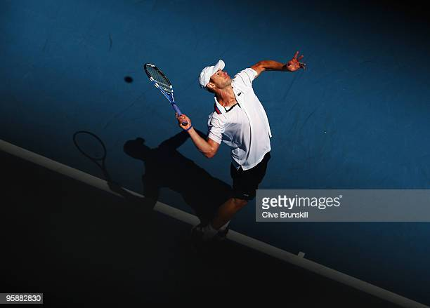 Andy Roddick of the United States of America serves in his second round match against Thomaz Bellucci of Brazil during day three of the 2010...