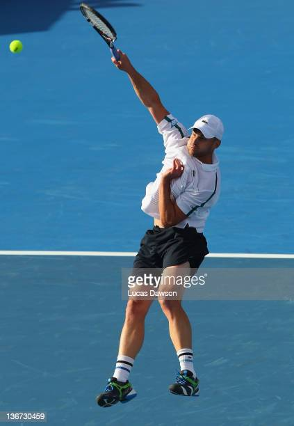 Andy Roddick of the United States plays a volley during his match against Gael Monfils of France during day one of the AAMI Classic at Kooyong on...