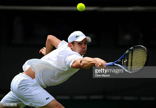 Andy Roddick of the United States reaches for a shot during his first round match against Andreas Beck of Germany on Day Two of the Wimbledon Lawn...