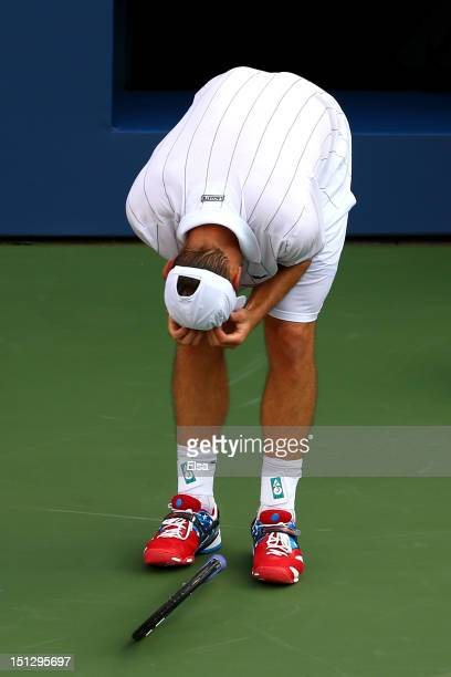 Andy Roddick of the United States reacts against Juan Martin Del Potro of Argentina during their men's singles fourth round match on Day Ten of the...