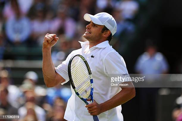 Andy Roddick of the United States reacts to a play during his first round match against Andreas Beck of Germany on Day Two of the Wimbledon Lawn...