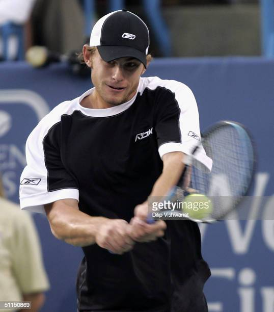 Andy Roddick of the United States returns a ball to Andre Agassi of the United States during the Western and Southern Financial Group Masters...