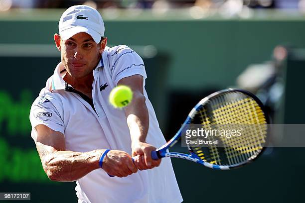 Andy Roddick of the United States returns a shot against Nicolas Almagro of Spain during day nine of the 2010 Sony Ericsson Open at Crandon Park...